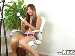 asian with huge big dildo in action