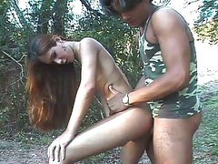 Amateur lady-boy roams the forest for military cock