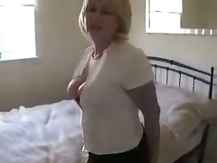 Hot video with outstanding amateur blond in dark nylons and high-heeled boots exposing her hairless pussy.