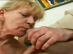 This hot granny bitch with wonderful milk shakes is sitting on the sofa and that babe is rubbing her her hairy vagina being very becoming very horny. A younger male appear and this stud begins licking her big milk shakes and the bitch is doing a cook jerking to him. Of course now the whore is sucking stud erectile lengthy schlong very nice.