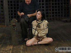 Sexy brunette Elise is all bound up and shackled and sits obedient on the floor near to her executor who puts a mask on her face. This guy explains this s&m technique and what this babe is supposed to do. The bitch enjoys being the center of attention and waits for her bondage treatment. Wanna see what happens to her?
