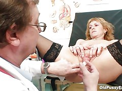 Older blonde Nora is a floozy with big boobs and big hairless vagina that is examined by a gynecologist. The doctor uses a metal speculum and gapes her pussy so we can watch inside it. This floozy seems to be healthy and her pussy is now willing for a hard fuck.