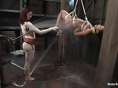 That girl needs an intensive washing and some spanking too and this bitch goddess knows how to do the job right! That babe hanged her and washed her fit sexy body until that babe putted down, tied her with another rope and secured her in a flawless position. Are u thinking for what is that dildo in the wall?