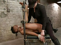 With her feet fastened up and metal clamps all over her body the ebon wench endures a harsh punishment. This goddess knows what he's doing and gives her both pain and pleasure. She can't even scream as her throat is folded with scotch tape. Look at that shaved cunt and how unfathomable she's rubbing it with the vibrator.