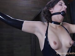 Brunette Marina wearing a darksome latex costume and having a large darksome ball gagging her mouth is about to be punished by her executor. The fellow starts with her zeppelins and uses very large suckers to torment 'em and when Marine's nipples are hard he ties 'em with rubber bands. Appears to be that babe will stay there for a long time