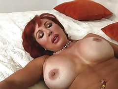 Her years of experience in fucking have a lot to say. Check out this gorgeous redhead milf and how lustfully this babe sucks and copulates cock. Damn the bitch knows how to drink a dick and when this babe goes on top and rides this stud we can clearly see her love tunnel lips spreading. Yep this milf needs some jizz deep inside her