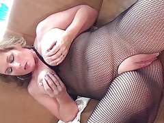 This hawt mature slut with big round tits is sitting on the bed wearing pantyhose and she is playing with her boobs. She starts rubbing her big bald pussy becoming very horny. The golden-haired takes now a lengthy sex-toy and starts riding it waiting the big orgasm coming soon.