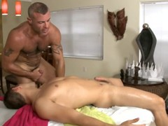 Cute homo guy is given a lusty spooning during massage