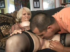 Mature blonde Sophie Mounds with soaked pierced snatch