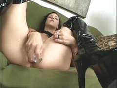 Horny girl in dark latex boots masturbates