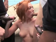 Red head doxy vixen vogel sucks down big hard rods