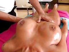 Lewd Angelina Valentine has her boobs rubbed with oil