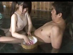 Asian Girl In Swimsuit Giving Oral In The Bath