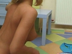 Blond teen in the bathroom