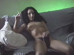 Brunette bitch with curly hair seduces her partner and receives her throat seriously fucked by him and her cookie penetrated in the doggy style.