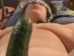Fastened up wife getting fucked with a big cucumber