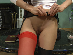 Hot gal with red nylons in her fur pie doing indecent things with her sex toy