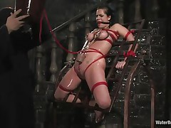 Mia Bangg is bound and gagged in the dungeon where her torturer sprays her nipple-clamped tits. This guy asks if she wishes to acquire fucked and she does, but 1st he gives her a little greater amount pain by pulling constricted the rope that splits her pussy lips and smacks her pussy in advance of using a dildo on her.