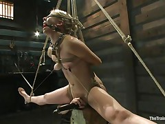 Chastity Lynn is a blonde milf who enjoys being fastened up with ropes. That hottie loves when that hottie is not able to move her hands and feet freely. As that hottie stands helpless with a ball gag in her face gap and a rope blindfold on her eyes, a ally is giving her a large time pleasure, rubbing her cunt with a vibrator.