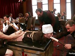 Slave angel is tied on the table at a sex party, while the other people are taking advantage of her and laughing. That babe has dildos in both her impure face hole and indecent cunt. The floozy is very thankful for this treatment and enjoys having her ass spanked by other horny floozy at the same time. Check this out!