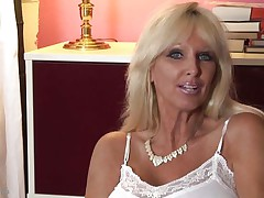 mature whores from usa are known to be sexy and naughty. Here we have Tia Gunn, a blonde bitch with giant meatballs and a lustful face that can give any guy an erection. This babe takes out her melons after a short talk and taunts us with 'em by squeezing 'em hard. Do u think this babe merits a cock betwixt her breasts and some semen?
