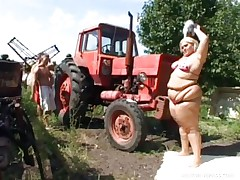 Melinda is so much woman she needs 2 studs to fuck her. Tibor and Gabor lift up her chubby folds and widen her arse cheeks. The both suck on her biggest melons outside by the tractor. The rubs every part of her big chubby gorgeous body.