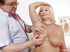 This blonde floozy is completely bare at the doctor. The doctor begins examining her large breasts with large and hot nipples. After that that man takes her pulse. The mature women is sitting on the daybed now with her large a-hole at the doctor. That man begin inspects her a-hole and large shaved vagina from behind.
