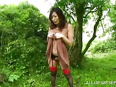 Nature loving Nippon angel is receiving her dose of wilderness! This cute bitch has her hands fastened on a tree branch and gets roughly drilled from behind. Her moans and screams won't help her cuz there's nobody around. Look at that sweet snatch being rubbed with a vibrator and then drilled hard.