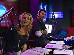The hosts of Playboy Radio's Morning Show are looking at their guest model who is wearing the costume she'll be wearing to the Playboy Mansion for Halloween. Her head and tits are overspread in fake fruit like oranges, limes, lemons, and more. She flashes her mambos for the hosts and viewers.