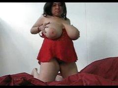 Fat solo girl sucks her huge tits