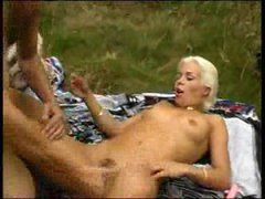 Betty using sextoy in the woods 2