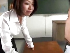 Teacher Giving Oral stimulation For Her Student In The Classroom