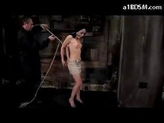 Beauty With Moutgag On High Heels Getting Bound Up And Hanged Teats Tortured With Movies In The Dungeon