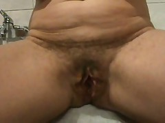 Ever wonder what an old bushy pussy looks like spread wide open?  Well now u don't have to wonder as this hottie shows her loose hanging lips pulled apart for everybody to see inside her cunt.  If you're into big loose pussy lips, this one is for u as this video is all pussy, all open. The only thing missing is he asshole.