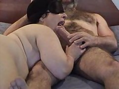 Masked chubby mature wife gives wonderful sucking and licking  to her hairy hubby\'s big dick - short but enjoyable