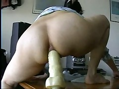 Watch this masked British play around on video with her boyfriend.  First this chick spreads her goods to show what this chick has to suggest before this chick straddles a huge marital-device up her ass.  Listen to her wince as this chick tries to get it up as far as this chick can take it up the pooper.  She's a real trooper as this chick does what her boyfriend tells her to do with the dildo.  Great way to train her for anal.