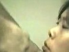 This horny asian wife takes a facial from hubby and spits cum out from her mouth.