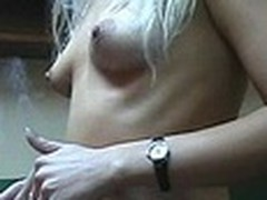Lecherous blond honey with petite sticking tits walks naked in her room filmed by her boy-friend with amateur cam in his hands. This guy doesn't like her smoking but actually enjoys her hot nude body shyly overspread by New Year tree decoration :)