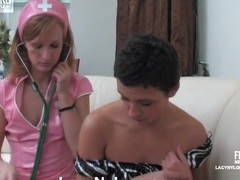 White-stockinged nurse going for nylon strap-on sex with her female patient