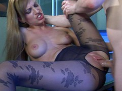 Oversexed gal in flower pattern pantyhose getting a leg over in the office