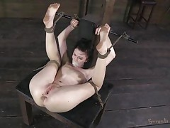Alana is a cute floozy that can't live out of being treated like a piece of meat. The executor tied her up in a very uncomfortable position, gagged her mouth with tape so that babe won't scream and now he's drilling her pussy. He goes deep in her bald slit and that's just for the warm up. Curious what's next?
