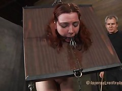 She's horrified of what's about to happen and who can blame the bitch? Take a look at her, how that sweetheart is secured in that bondage device and has a device in her face hole that keeps it opened. The executor doesn't wastes time and spanks her white booty previous to fucking her face hole and shaved muff with a big dildo.