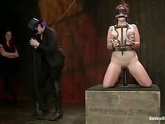 And so is a kinky session of bdsm! This doxy stays in her knees all tied up and with her love melons squeezed while her mistress, just like she is, has a blindfold around her eyes. The mistress spanks the floozy with an electric wand and the rest is for you to see and have a fun it!
