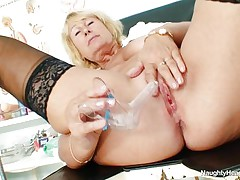This granny nurse is lying on medical couch and this hottie crave to play with her hot pussy at work. She have big and round mambos and a hairless and large vagina. The golden-haired nurse have a lengthy dildo and this hottie introduce it very deep in the vagina 'cuz this hottie crave to have a great orgasm.