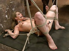 Take a look how hard her cum-hole is sucked! The golden-haired babe is about to receive a hard castigation from her experienced mistress. She hangs her upside down, removes the sucker and oils her pussy. After that the dominatrix-bitch fingers deeply the blonde's fur pie and makes her shriek insanely and almost to cum!