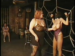 Here's a oldie but goldie bdsm. Headmistress Bianca taunts her female sex thrall not only with her large delicious boobs but with her skills too. That babe ties Carla's large breasts with rope and squeezed 'em hard after that babe played with them. Carla will have to obey the will of her mistress 'coz she's fastened hard