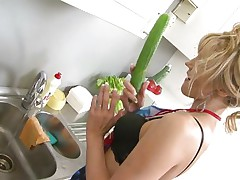 Zlata was in the kitchen cooking smth when she suddenly felt like masturbating. Because she was horny as hell she grabbed the 1st thing she though will assist her fuck her pussy. Using a cucumber Zlata fucked her shaved cunt deeply and then she wanted even more. Curious what she did next?