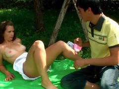 Gracious dick-engulfing is being delivered to a dude outdoors