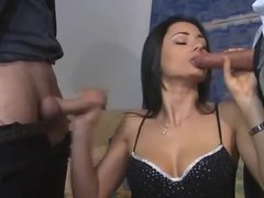 Euro beauty in boots feasts on two dicks