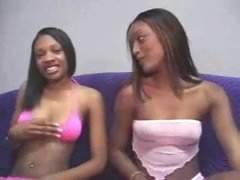 Youthful darksome beauty sits and sucks his knob